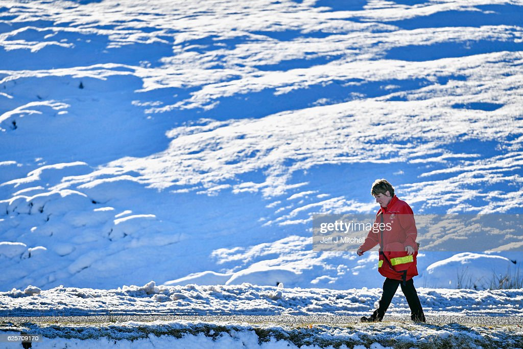 Postwoman Fiona Scott delivers mail in Scotlands highest village on November 25, 2016 in Wanlockhead,Scotland. Widespread hard frost and patchy fog continues across many parts of Scotland and Northern Ireland.