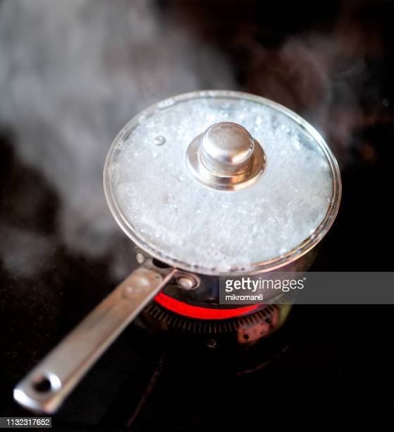 pot boil over. food boiling in utensil at kitchen - boiled stock pictures, royalty-free photos & images