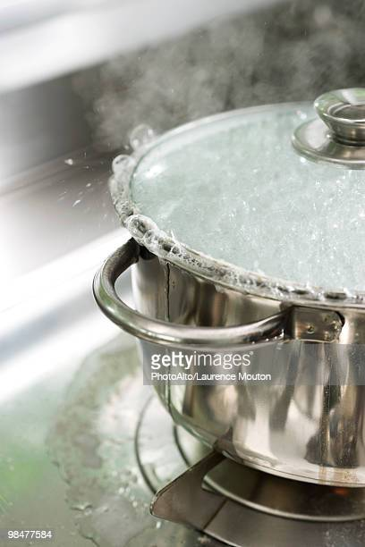 pot boiling over - lid stock photos and pictures