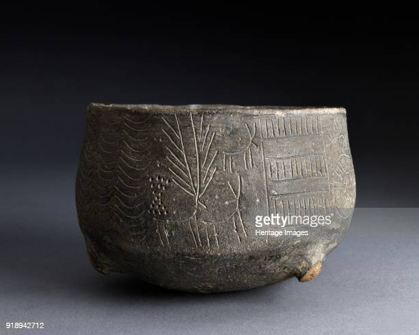 Pot Chalcolithic Period Grit tempered pot with incised decoration of stag and hinds Rounded base four short legs one central internal stump now...