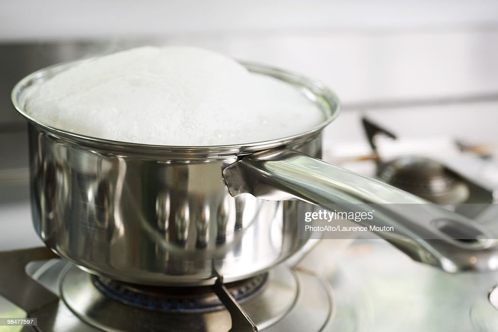 Pot cooking on stove : Stock Photo