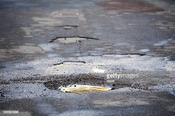 pot hole on asphalt road - hole stock pictures, royalty-free photos & images