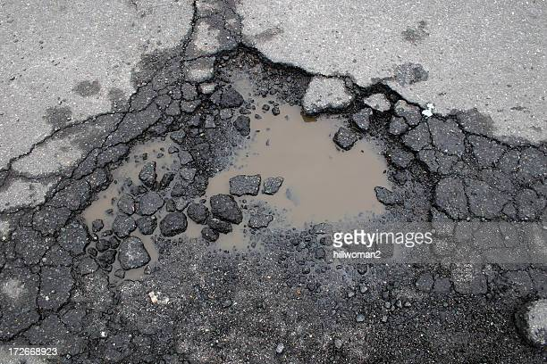 pot hole - pothole stock photos and pictures