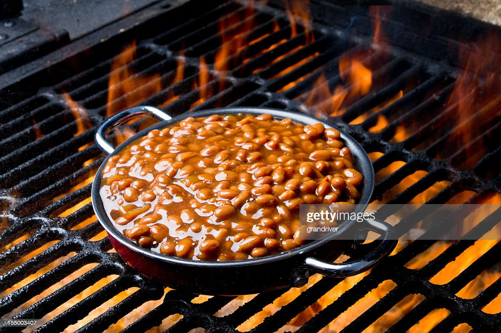Pot of Baked Beans on a Flaming Grill : Stock Photo