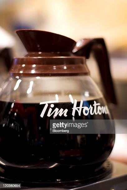 A pot of coffee stands at a Tim Hortons Inc restaurant in Toronto Ontario Canada on Wednesday Aug 3 2011 Tim Hortons Inc is a chain of franchise fast...