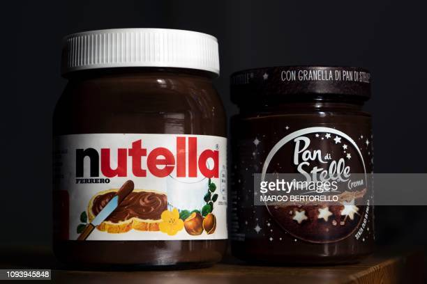 A pot of the chocolate spread Crema Pan di Stelle made by Italian pasta and biscuits giant Barilla is pictured near a Nutella pot in Manta near Cuneo...