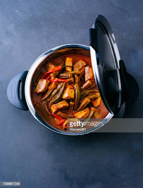 Pot of veal stew with okras