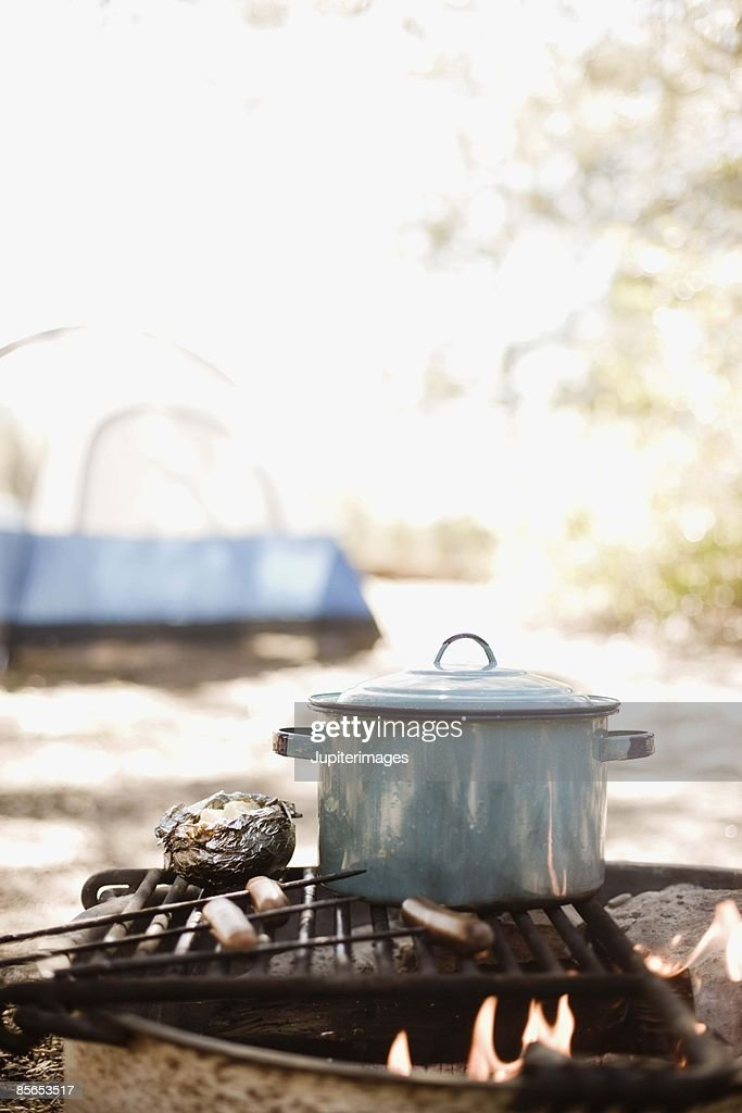 Pot on grill at campsite : Stock Photo