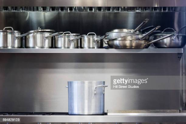 pot on stove in commercial kitchen - stainless steel stock pictures, royalty-free photos & images