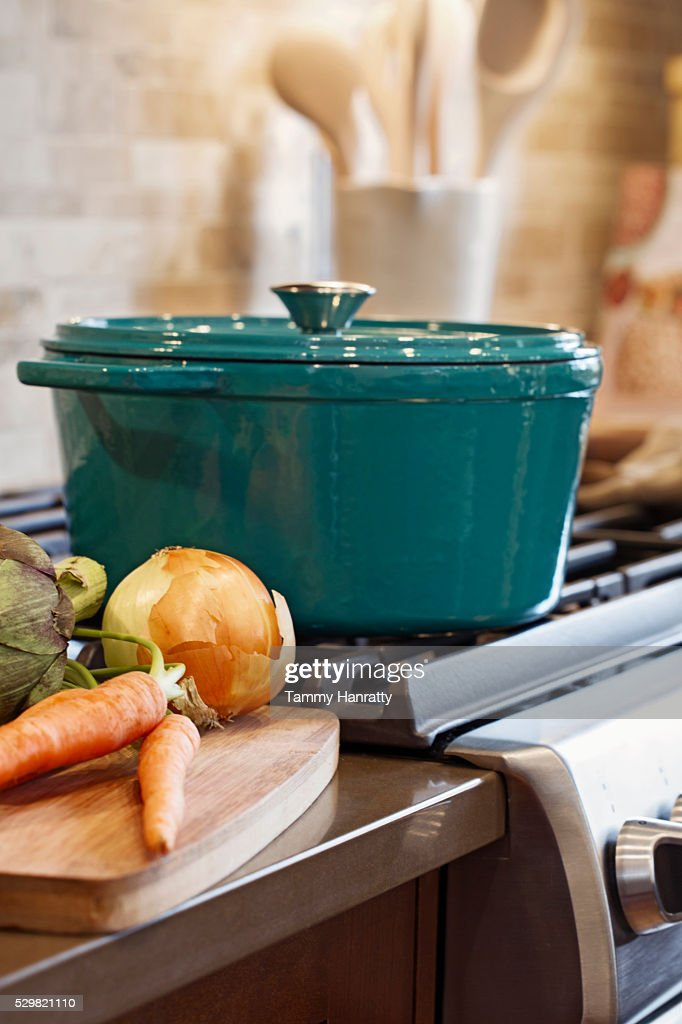 Pot on stove in domestic kitchen : Stock Photo
