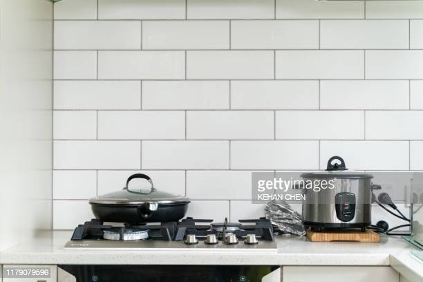 pot pan and rice cooker in kitchen - cooking illustrations stock pictures, royalty-free photos & images