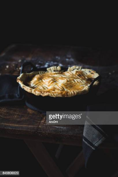 Pot pie on wooden table