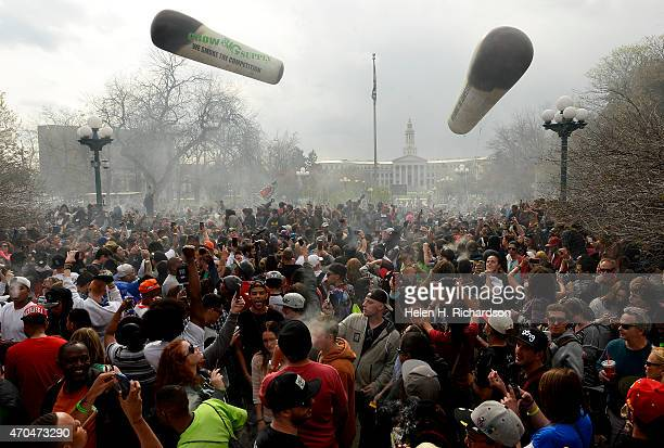 Pot smokers partake in smoking marijuana at exactly 420 during the annual 420 celebration in Lincoln Park near the State Capitol in Denver Colorado...