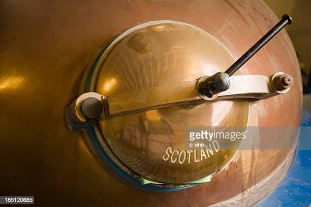 Pot still lid in whiskey distillery