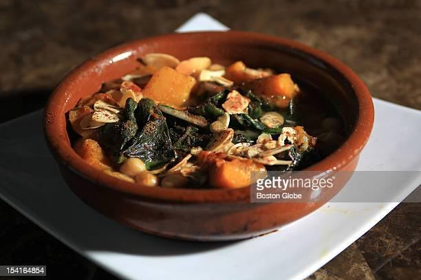 Potaje Andaluz a dish of Sauteed Rainbow Chard Butternut Squash Chickpeas Almonds Golden Raisons