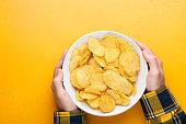 potato chips crisps bowl male hands