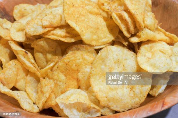 potato chips served in a wooden bowl - rafael ben ari stock pictures, royalty-free photos & images