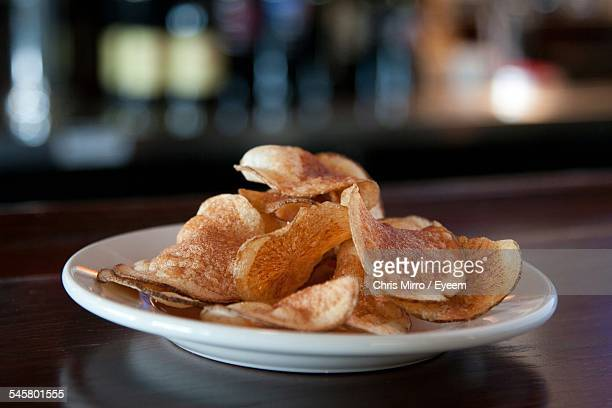 Potato Chips Served On Plate