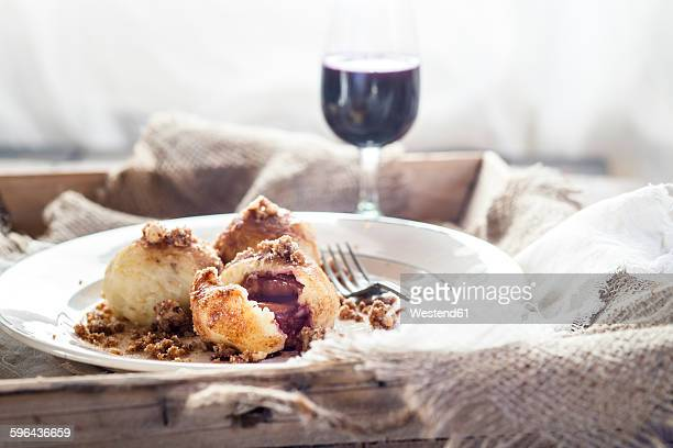 Potato dumplings, filled with plums, cinnamon, sugar and nuts on plate