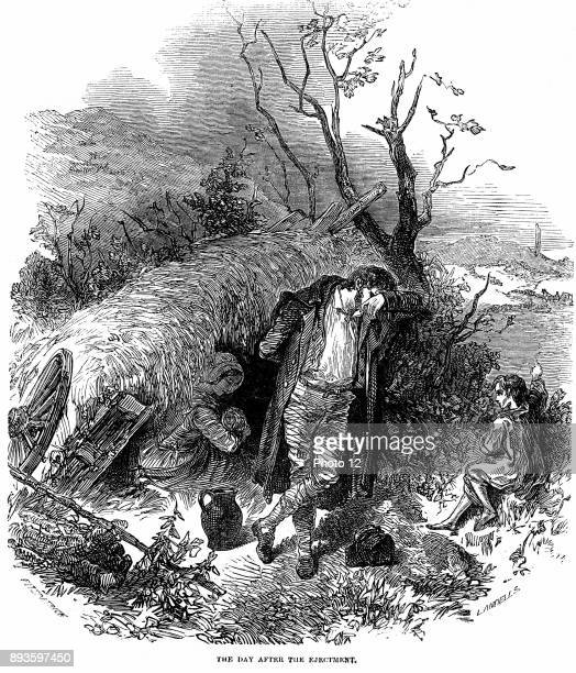 Potato Famine Irish peasant family unable to pay rent because of failure of potato crop due to blight finding shelter in a hedgerow the day after...