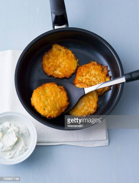 potato fritters in frying pan - fritter stock photos and pictures