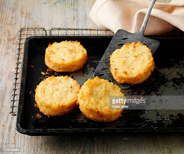 potato rosti cakes on baking tray and wire rack - prepared potato stock pictures, royalty-free photos & images