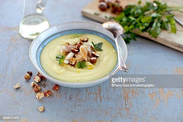 Potato soup with smoked fish and hazelnut