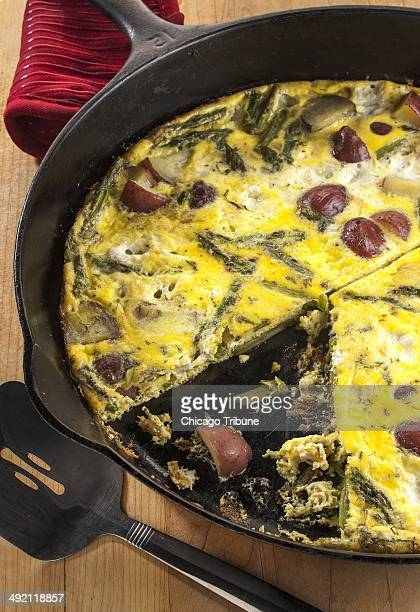 Potatoes and asparagus make the filling for this frittata