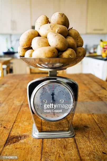 Potatoes being weighed on kitchen scales