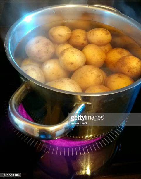Potatoes boiling in pan