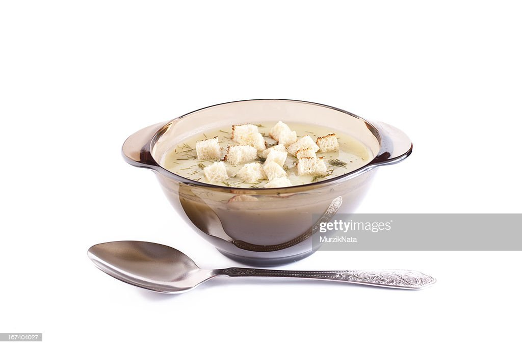 potatoes cheese cream soup in a glass plate : Stock Photo