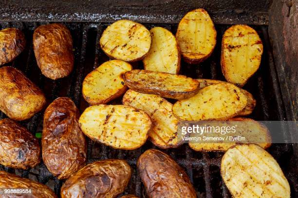 potatoes on barbecue grill - prepared potato stock pictures, royalty-free photos & images