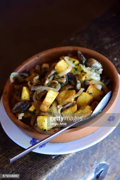 Potatoes, onions and mushrooms in claypot