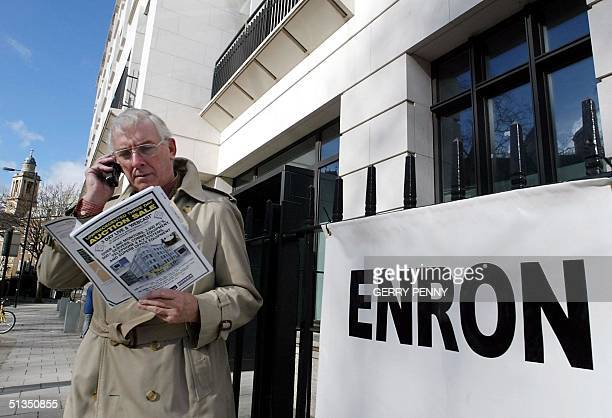 Potential bidder John Hanford looks through the Enron auction brochure 27 February 2002 for office equipment at the start of a three day sale at the...
