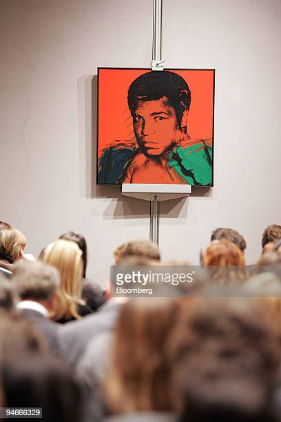 Potential bidders look at Muhammad Ali by Andy Warhol at the PostWar and Contemporary Art auction in New York US on Tuesday Nov 13 2007 A sultry 1955...