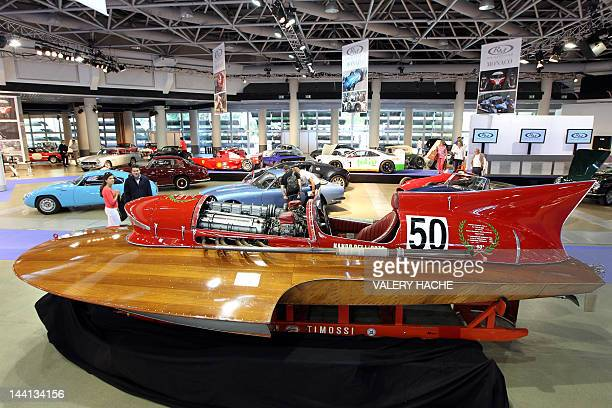 A potential buyer and visitor looks at the 1953 Timossi Ferrari Arno XI Racing Hydroplane at the Grimaldi Forum in Monaco on May 10 on the eve of the...