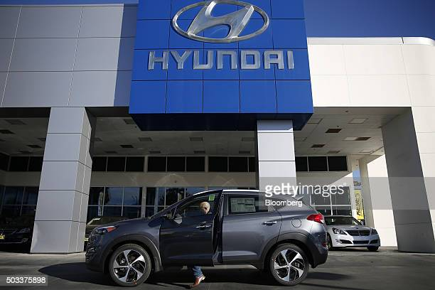 A potential car buyer enters a Hyundai Motor Co Tuscon compact sports utility vehicle on the lot of the Keyes Hyundai dealership in the Van Nuys...