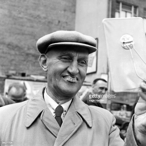 A potential customer checks the fit of a set of dentures in the Waterlooplein marketplace Amsterdam There tradesman Gerard de Munnik sells second...