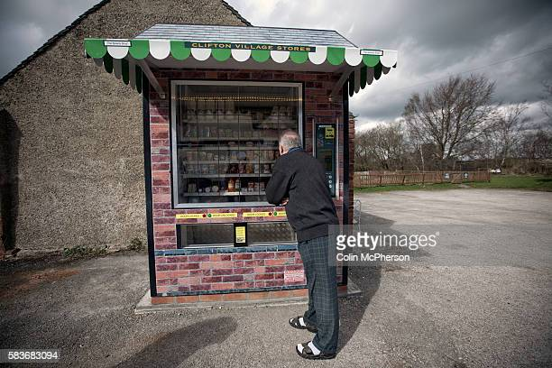 A potential customer looking at items in the giant vending machine designed and installed by local businessman Peter Fox in the tiny Derbyshire...