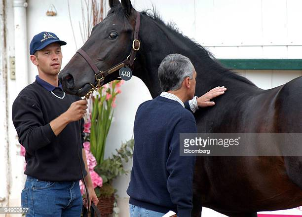 A potential horse buyer examines a yearling at the Deauville horse auction Tuesday August 23 2005 The Deauville thoroughbred auction a French...