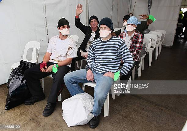 Potential illegal immigrants wait to be processed during a simulated mass arrival of asylum seekers at Devonport's Naval Base on June 19 2012 in...
