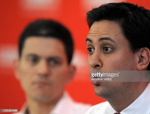 Potential new Leader of the Labour Party Ed Miliband speaks watched by brother David during the Yorkshire and Humber Labour hustings, in Leeds, on...