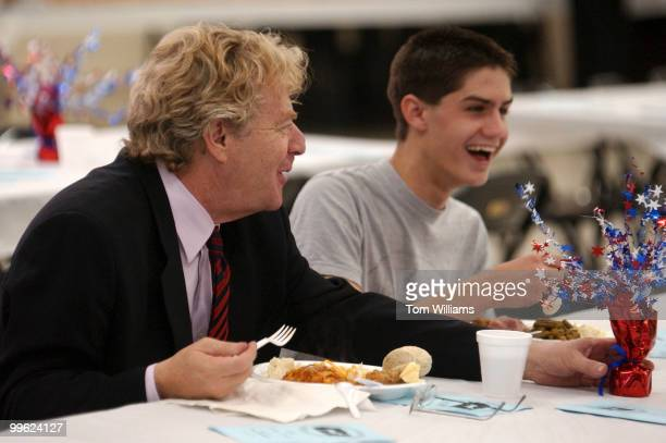 Potential Senate candidate Jerry Springer DOhio shares a laugh with Mike Barnhart at the Ross County Democratic Party Spring Dinner in Chillicothe...