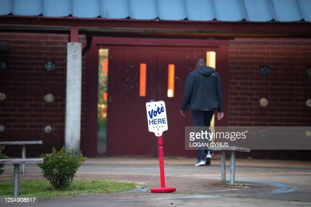 Potential voter walks into their voting precinct to cast a ballot at First Ward Creative Arts Academy during the North Carolina primary on Super...
