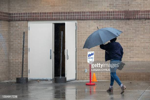 Potential voters arrives to cast a ballot at the Oasis Shriners Temple polling station during the North Carolina primary on Super Tuesday in...