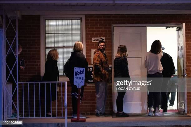 Potential voters wait in line at Midwood Baptist Church to cast a ballot in the North Carolina primary on Super Tuesday in Charlotte, North Carolina...