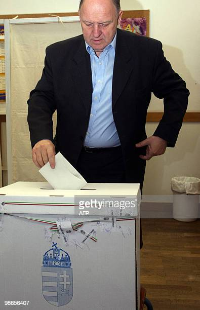 A potentional representativecandidate of the governing Socialist party Jozsef Horvath puts his ballot into the box at the 93rd polling station of...