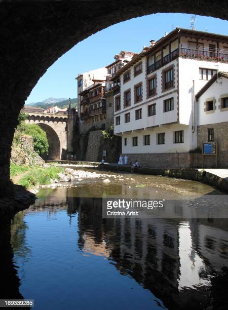Potes, view under one of the bridges crossing the river Quiviesa, Cantabria, Spain.