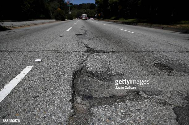 A pothole is visible on a street on May 15 2017 in San Francisco California San Francisco mayor Ed Lee announced a twoyear $90 million street repair...