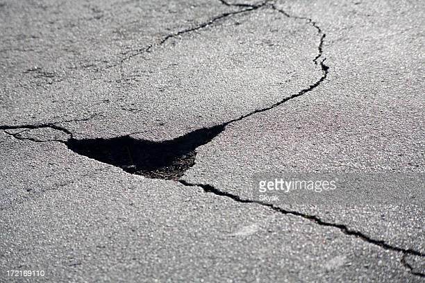 pothole - pothole stock photos and pictures